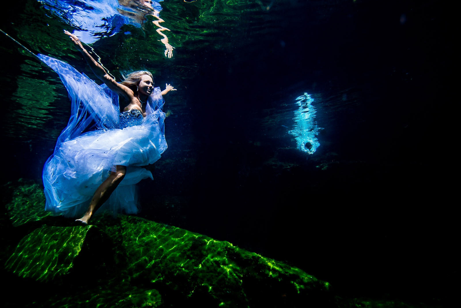 Post wedding underwater photography trash the dress